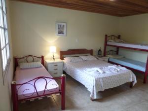 Pousada Canto do Lago, Гостевые дома  Пиракая - big - 100