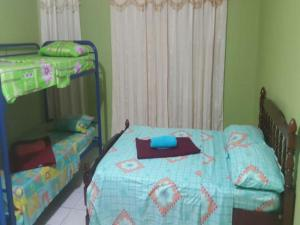 Single Bed in Dormitory Room Caribbean Paradise
