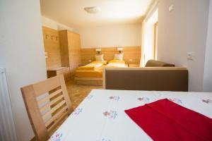 Appartamenti Genziana - AbcAlberghi.com