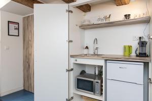 L'Home Apartment.  Foto 11