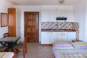 Apartments Villa Supertom, Ferienwohnungen  Povljana - big - 37