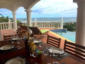 Your Paradise Villa, Holiday homes  Orient Bay - big - 10
