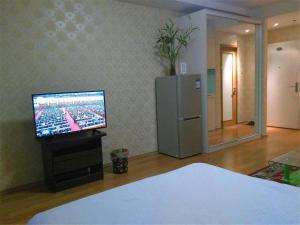 Beijing Tiandi Huadian Hotel Apartment Youlehui Branch, Ferienwohnungen  Peking - big - 28