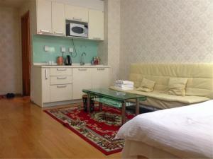 Beijing Tiandi Huadian Hotel Apartment Youlehui Branch, Ferienwohnungen  Peking - big - 25