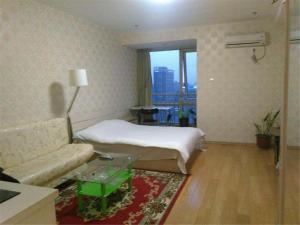 Beijing Tiandi Huadian Hotel Apartment Youlehui Branch, Ferienwohnungen  Peking - big - 23