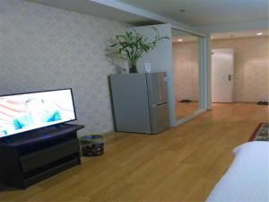 Beijing Tiandi Huadian Hotel Apartment Youlehui Branch, Ferienwohnungen  Peking - big - 20