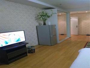 Beijing Tiandi Huadian Hotel Apartment Youlehui Branch, Ferienwohnungen  Peking - big - 19