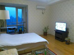 Beijing Tiandi Huadian Hotel Apartment Youlehui Branch, Ferienwohnungen  Peking - big - 18