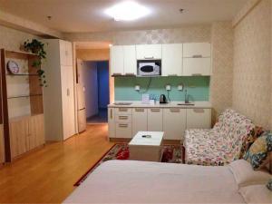 Beijing Tiandi Huadian Hotel Apartment Youlehui Branch, Ferienwohnungen  Peking - big - 4