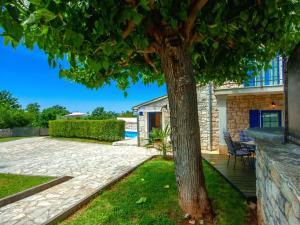 Casa Nadalina, Holiday homes  Rapavel - big - 37