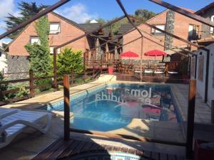 Loma Escondida Apart Cabañas & Spa, Turistaházak  Villa Gesell - big - 20