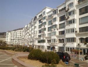 Qingdao Dusco Holiday Apartment Shilaoren Park, Apartmanok  Csingtao - big - 1