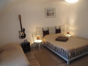Chambres et Tables d'hôtes à l'Auberge Touristique, Bed and breakfasts  Meuvaines - big - 42