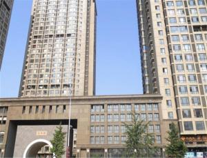Dalian Development Zone Zuoan Jingdian Shishang Apartment, Apartmány  Jinzhou - big - 1