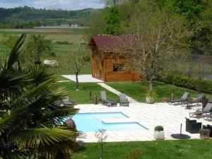 Location gîte, chambres d'hotes Les Chalets du Manoir dans le département Tarn et Garonne 82