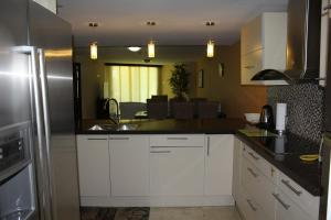 Oasis Ocean View, Appartamenti  Palm-Eagle Beach - big - 12