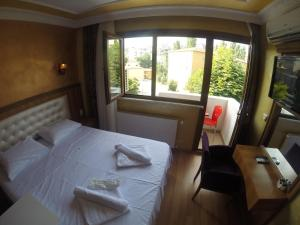 Arat Apartments, Апарт-отели  Стамбул - big - 141