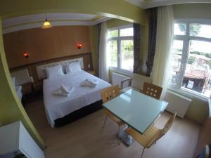 Arat Apartments, Апарт-отели  Стамбул - big - 147