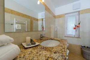 Majon Vajolet - Apartments Luisa, Apartmanok  Vigo di Fassa - big - 24