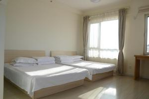 Gold Holiday Apartment, Апартаменты  Jinzhou - big - 12