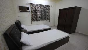 Afaq Al Elm Aparthotel, Апарт-отели  Унайза - big - 14