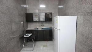 Afaq Al Elm Aparthotel, Апарт-отели  Унайза - big - 23