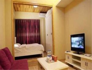 Gold Holiday Apartment, Апартаменты  Jinzhou - big - 16