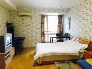 Beijing Tiandi Huadian Hotel Apartment Youlehui Branch, Ferienwohnungen  Peking - big - 11
