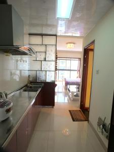 Yi Jia Apartment, Apartments  Kunming - big - 8