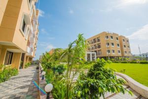 Auberges de jeunesse - Budget Inn Service Apartments - Tiger Plaza