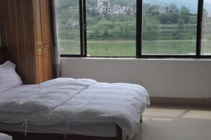 Auberges de jeunesse - Bama Huifu Zhongyi Villige Chifu Lake Apartment