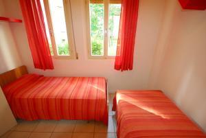 Villetta Ambra, Dovolenkové domy  Lignano Sabbiadoro - big - 13