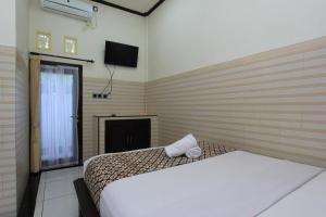 RedDoorz near Taman Ayun Mengwi, Guest houses  Mengwi - big - 8