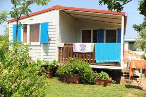 Camping Village Tavolara - AbcAlberghi.com