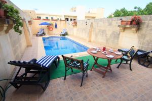 Ta' Bejza Holiday Home with Private Pool, Dovolenkové domy  Xewkija - big - 55