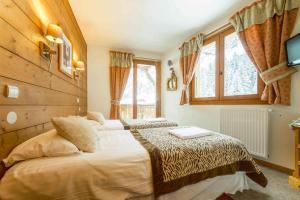 Location gîte, chambres d'hotes Hôtel et Chalet Au Coin Du Feu Chilly Powder dans le département Haute Savoie 74