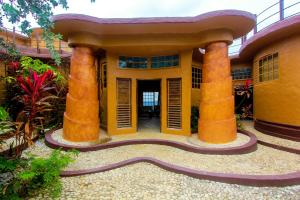 Great Huts: Africana House