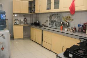Pele Guesthouse, Penzióny  Bandung - big - 38