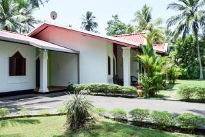 Asnaka Villa, Vily  Hikkaduwa - big - 37