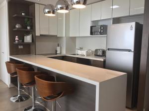 Apartamento Parque Arauco Kennedy, Ferienwohnungen  Santiago - big - 8