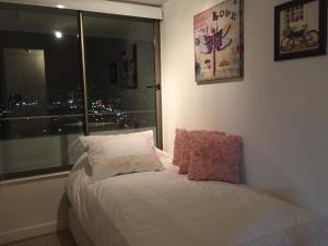 Apartamento Parque Arauco Kennedy, Ferienwohnungen  Santiago - big - 17