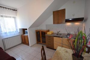 Apartments Petrica, Апартаменты  Малинска - big - 9