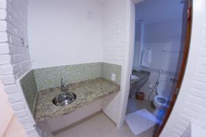 Hotel Residencial Portoveleiro, Гостевые дома  Кабу-Фриу - big - 14