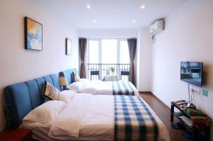 Chongqin Rongshuxia Youpin Apartment, Appartamenti  Chongqing - big - 4