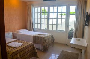 Hotel Residencial Portoveleiro, Гостевые дома  Кабу-Фриу - big - 104