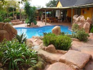 Flintstones Guesthouse Fourways, Penzióny  Johannesburg - big - 21