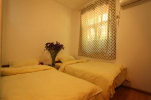 Dengba International Youth Hostel Jinan Branch, Хостелы  Цзинань - big - 5