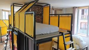 Location gîte, chambres d'hotes La Maison Rouge - Backpacker Hostel dans le département Loire 42