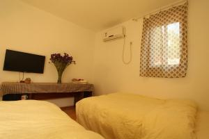 Dengba International Youth Hostel Jinan Branch, Хостелы  Цзинань - big - 23