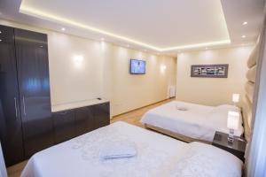 Grand Lakes Rooms, Vendégházak  Jezerce - big - 29
